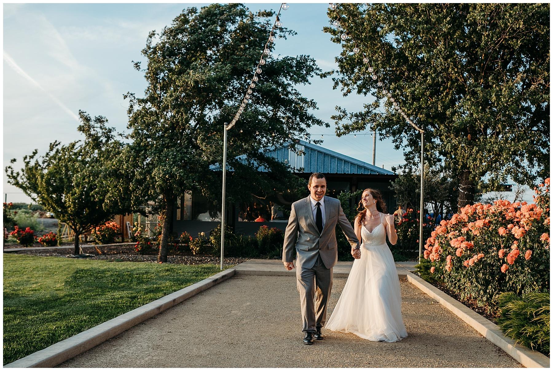 bride and groom walking away Julietta Winery sunset photos