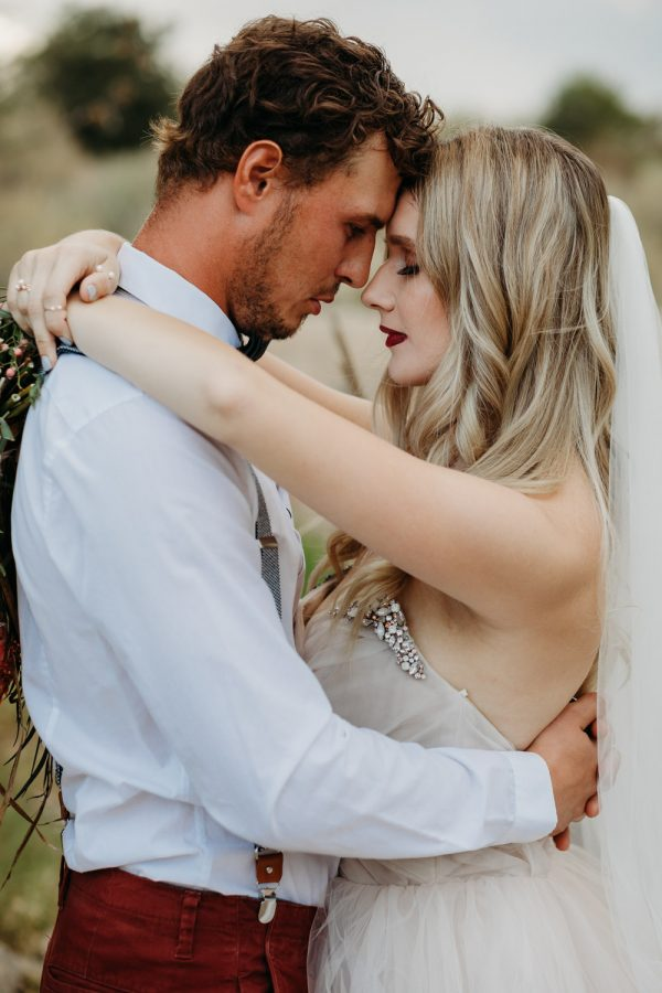 quiet moment of bride and groom embracing one another lake tahoe elopement